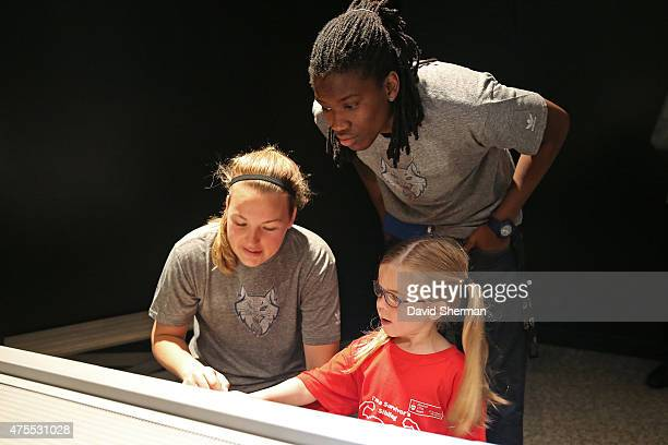 Tricia Liston and Amber Harris of the Minnesota Lynx visit the Science Museum of Minnesota with Wishes More Kids and their families on May 29 2015 in...