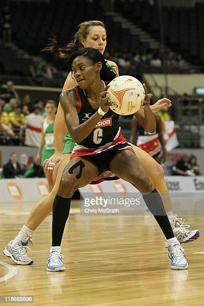 Tricia Liverpool of Trinidad and Tobago looks to pass under pressure from Lisa McCaffrey of Northern Ireland during the match between Northern...