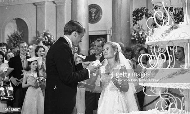Tricia Nixon Cox and Edward Cox enjoying their wedding cake at the White House