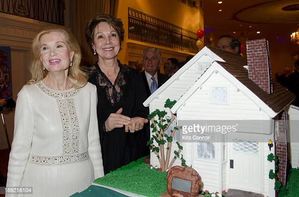 Tricia Nixon Cox and Julie Nixon Eisenhower pose for a photo with the birthday cake during President Nixon's 100th Birthday Gala on January 9 2013 in...