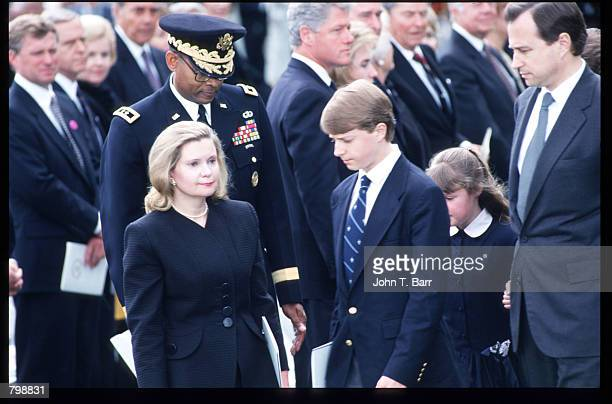 Tricia Nixon Cox stands with her family at the memorial service for her father former President Richard Nixon April 27 1994 in Yorba Linda CA Nixon...