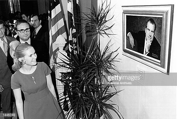 Tricia Nixon looks at painting of her father, President Richard Nixon, painted by Norman Rockwell May 8, 1972.