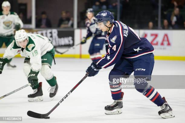 TriCity Americans defenseman Roman Kalinichenko looks to make a pass in the offensive zone during Game 1 of the divisional playoff series between the...