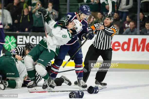 TriCity Americans defenseman Samuel Stuart grabs Everett Silvertips defenseman Ronan Seeley out of the pile during a game between the TriCity...