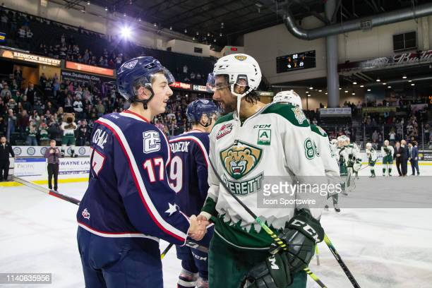 TriCity Americans forward Kaden Kohle shakes hands with Everett Silvertips defenseman Sahvan Khaira after Game 5 of the divisional playoff series...