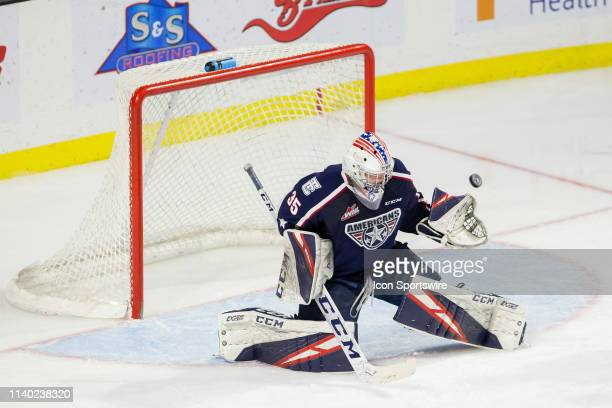 TriCity Americans goaltender Beck Warm makes a glove save during the second period of Game 1 of the divisional playoff series between the Everett...