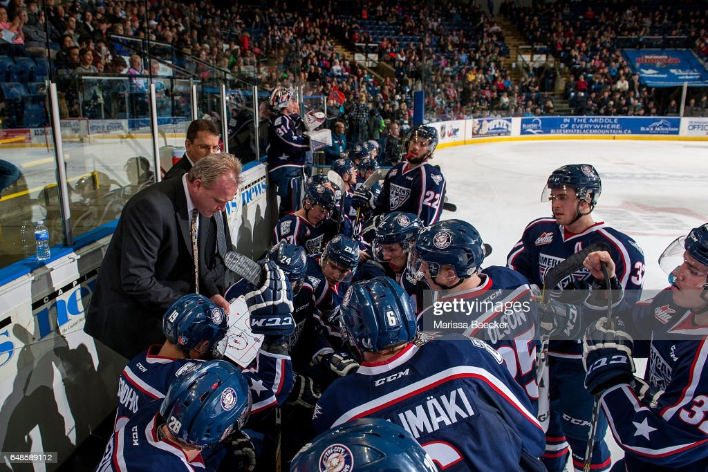 Tri-City Americans' head coach Mike Williamson goes over a play on the bench during a time out against the Kelowna Rockets on March 4, 2017 at Prospera Place in Kelowna, British Columbia, Canada.