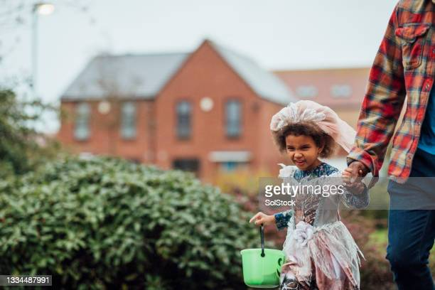 trick or treat in the rain - mid adult men stock pictures, royalty-free photos & images