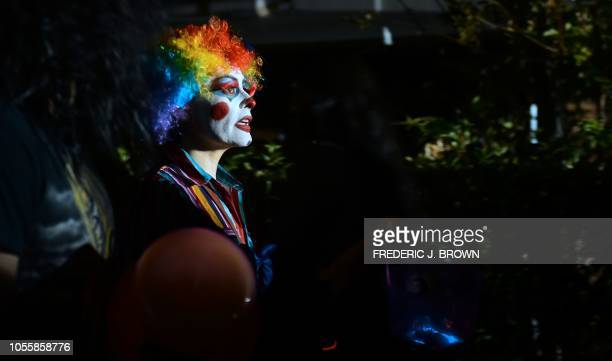 Trick or Treaters out for a walk on a street popular for its tradition of home decorations on Halloween Night in Sierra Madre east of Los Angeles on...