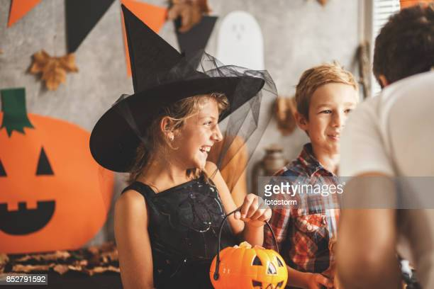 trick or treaters - halloween party stock photos and pictures
