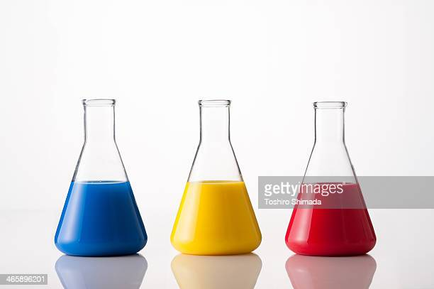 tricolor conical flask - laboratory equipment stock photos and pictures