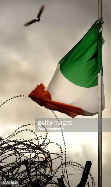 A tricolour flag is caught in barbed wire in nationalist west Belfast on April 10 2008 in Northern Ireland In the 10 years since the Good Friday...