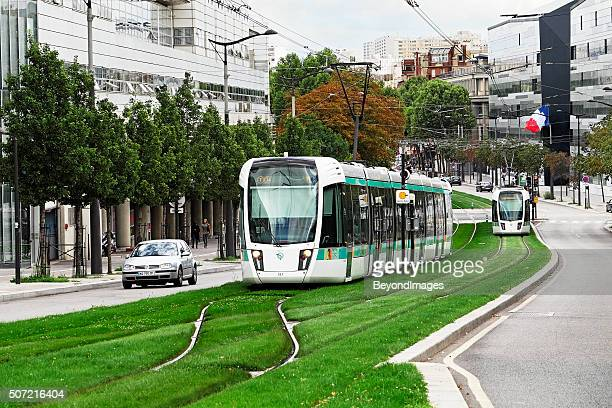 Tricolour flies as Paris tram approaches terminal while another departs
