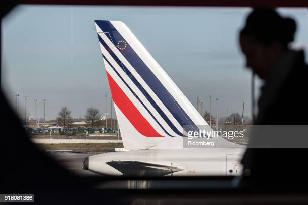 Tricolour livery sits on the tail fin of an Air France passenger aircraft operated by Air FranceKLM Group as it stands on the tarmac at Charles de...