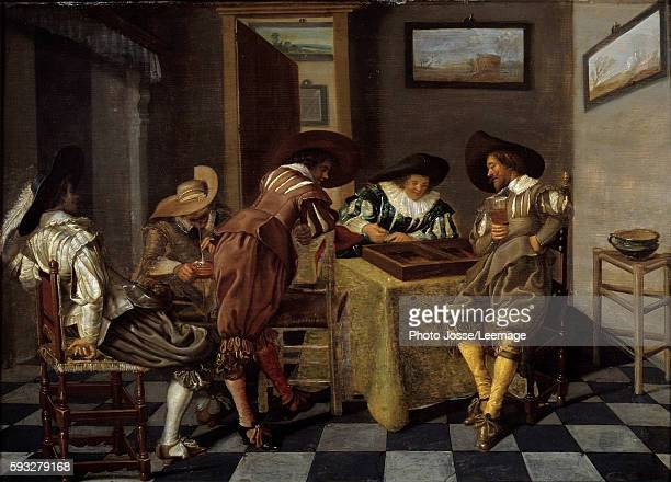 Trictrac players Painting by Dirk Hals circa 16151625 Oil on wood 038 X 053 m Beaux Arts Museum Lille France