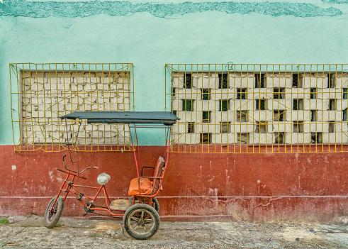 Tricycle agains wall in Havana Cuba - gettyimageskorea
