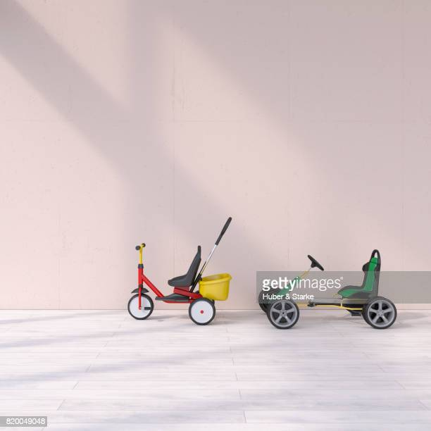 Tricycle and pedal car in a row