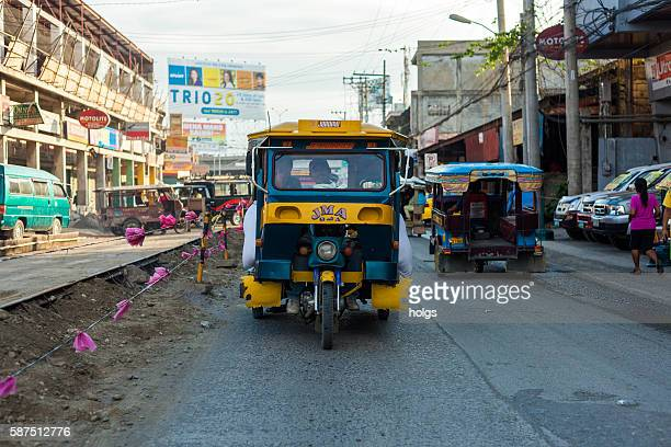 tricycle in the streets of davao - davao city stock photos and pictures