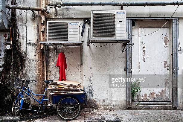 A tricycle is parked behind a shophouse along Club Street on April 2 2013 in Singapore A shophouse is a vernacular architectural building type that...