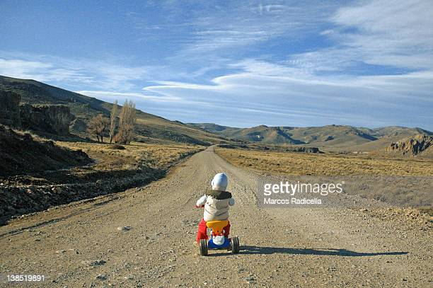 tricycle on patagonian route - radicella stock pictures, royalty-free photos & images
