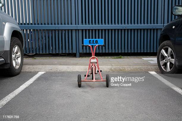 Tricycle parked in CEO space in carpark