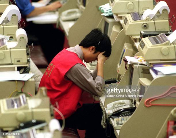 Tried and depressed stock traders at the Hong Kong Stock Exchange. 01 September 2001