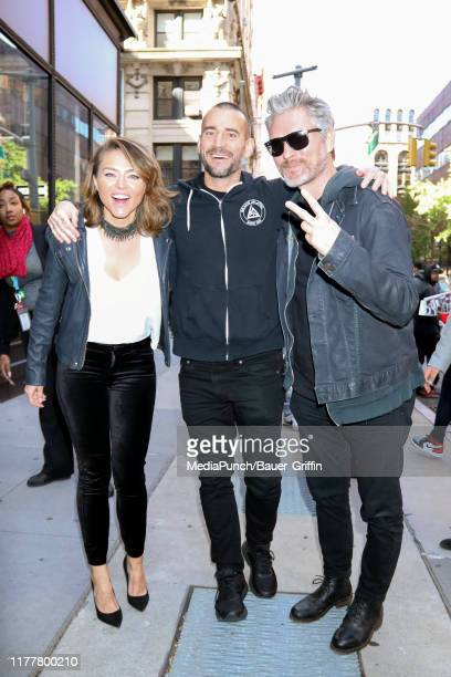 Trieste Kelly Dunn Phil 'CM Punk' Brooks and Travis Stevens are seen outside the Build Studio on October 23 2019 in New York City