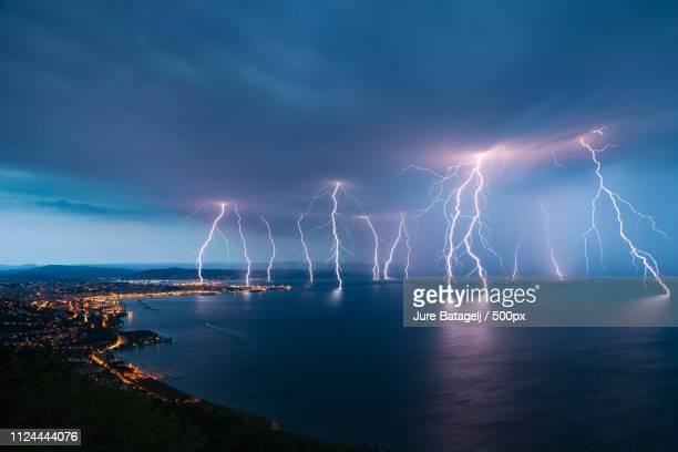 trieste lightning - gewitterblitz stock-fotos und bilder