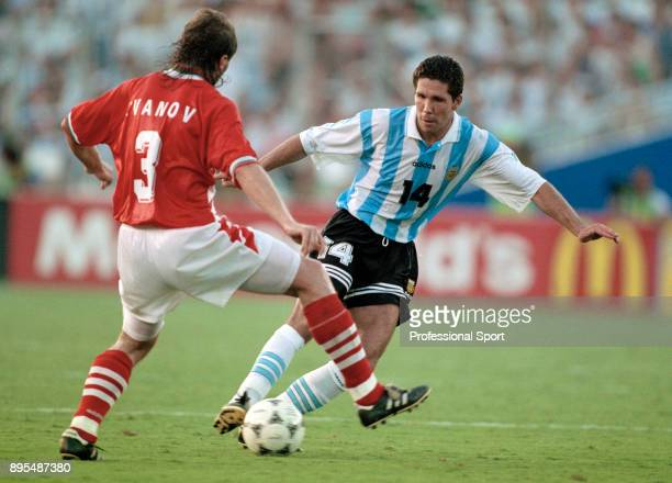 Trifon Ivanov of Bulgaria closes down Diego Simeone of Argentina during a 1994 FIFA World Cup group game at the Cotton Bowl on June 30 1994 in Dallas...