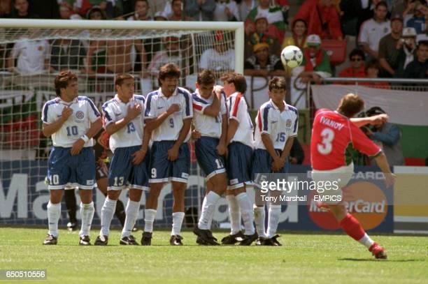 Trifon Ivanov of Bulgaria curls a free kick around the Paraguay defensive wall