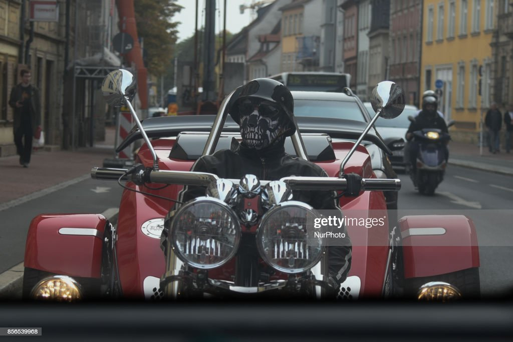 A trike driver waring a full face mask, dressed like Death driving in Bamberg, Germany, on September 30, 2017.