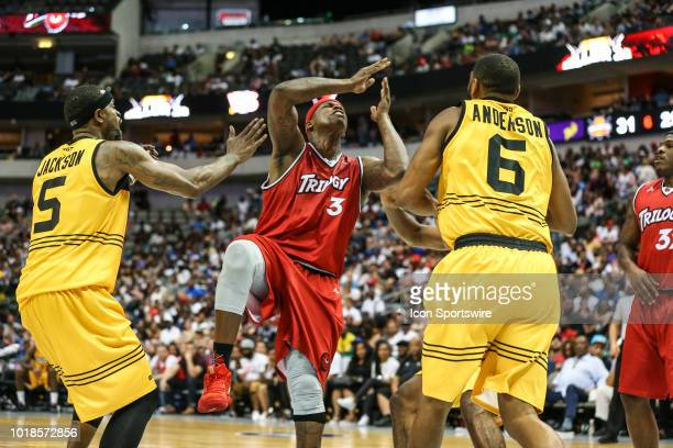 Trilogy Al Harrington gets fouled by Killer 3's Stephen Jackson and Alan Anderson during the Big 3 Basketball playoff game between the Trilogy and...