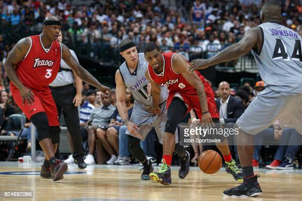 Trilogy guard James White dribbles as Ghost Ballers guard Mike Bibby and forward Ivan Johnson defend during the Big3 basketball game between the...