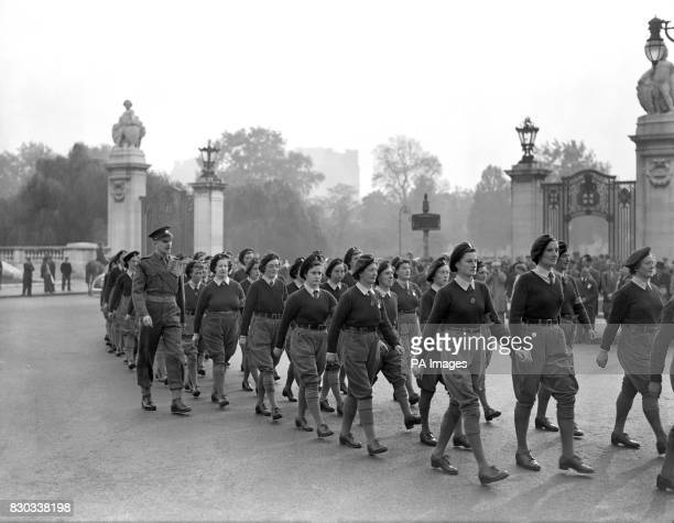 Trim and neat in their uniform of green and corduroy breeches 500 members of the disbanding Women's Land Army march from Wellington barracks to...