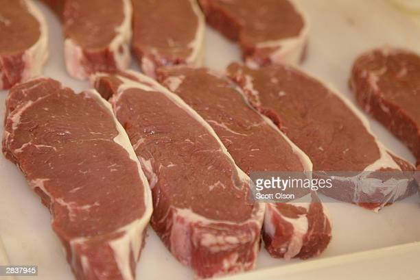 Trimmed New York Strip steaks sit on the cutting table before being packaged and frozen at Heartland Meats December 30 2003 near Mendota Illinois...