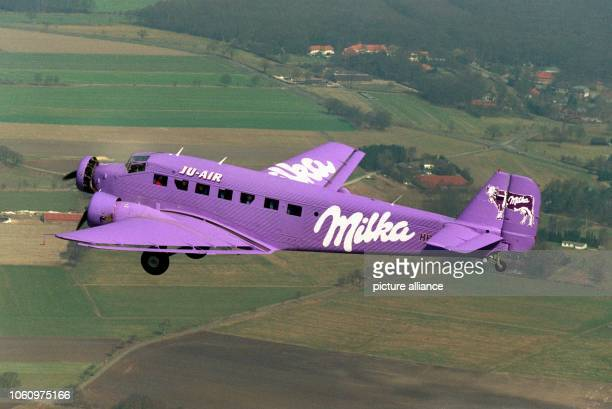 Trimotored airplane JU52 is painted in the purple Milka colour for an advertising campaign on the 17th of April in 1996