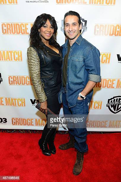 "Trina Braxton and Gabe Solis attends the ""Grudge Match"" screening at AMC Parkway Pointe on December 17, 2013 in Atlanta, Georgia."