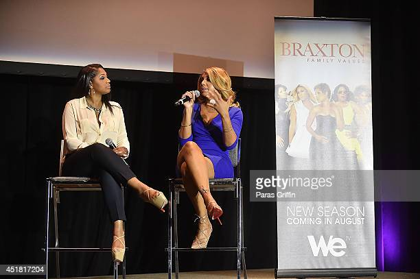 Trina Braxton and Tamar Braxton attends the 2014 Essence Music Festival on July 6, 2014 in New Orleans, Louisiana.