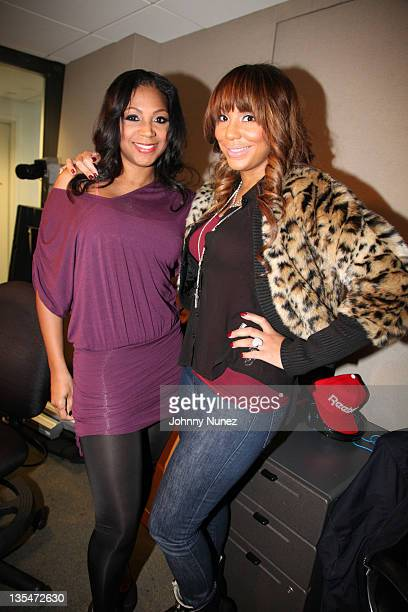Trina Braxton and Tamar Braxton invade the Whoolywood Shuffle at SiriusXM Studio on December 07, 2011 in New York City.