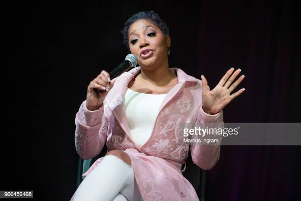 Trina Braxton speaks on stage during the Atlanta Ultimate Women's Expo at Georgia World Congress Center on June 2 2018 in Atlanta Georgia