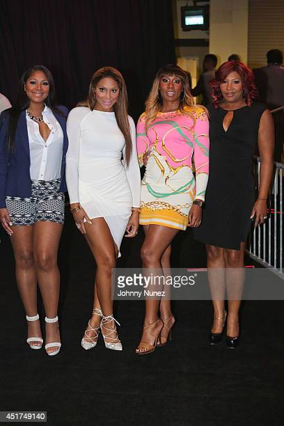Trina Braxton, Tamar Braxton, Towanda Braxton and Traci Braxton attend the 2014 Essence Music Festival on July 5, 2014 in New Orleans, Louisiana.