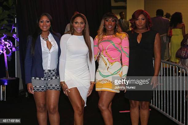 Trina Braxton, Tamar Braxton, Towanda Braxton and Traci Braxton attend the 2014 Essence Music Festival on July 5, 2014 in New Orleans, Louisiana.