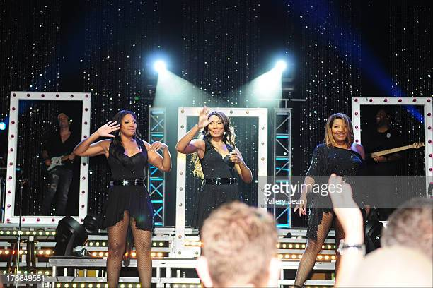 Trina Braxton, Towanda Braxton and Tamar Braxton perform during Toni Braxton concert at James L Knight Center on August 29, 2013 in Miami, Florida.