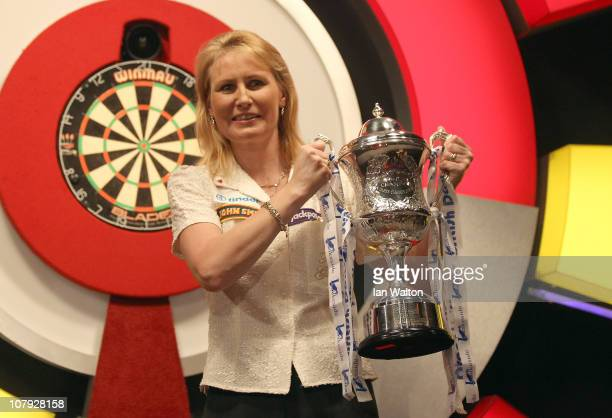 Trina Gulliver of England celebrates with the trophy after winning against Rhian Edwards of Wales in the Womens Final on January 7 2011 in Frimley...