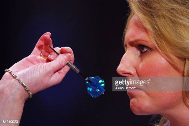 Trina Gulliver of England in action against Karin Krappen of the Netherlands during the Lakeside Women's World Professional Darts Championships...