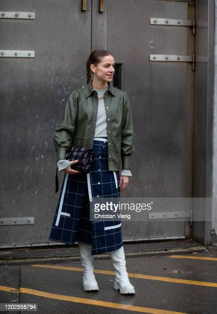 Trina Kjaer wearing olive jacket, checkered navy skirt, white boots and seen outside Rave Review on Day 1 during Copenhagen Fashion Week...