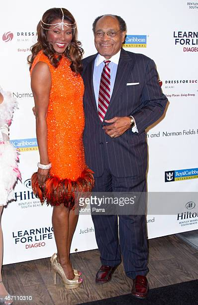Trina Robinson and guest attend Dress for Success Miami Celebrates 20th Anniversary at The Rusty Pelican on October 11 2014 in Key Biscayne Florida