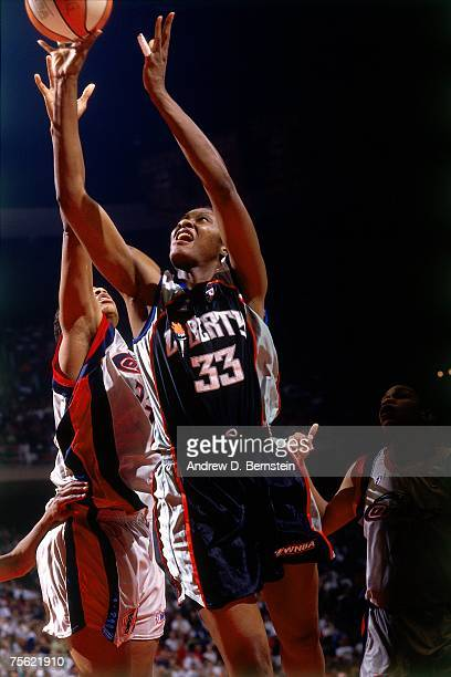 Trina Trice of the New York Liberty attempts a layup against the Houston Comets during the 1997 WNBA Finals in August of 1997 at the Summit in...