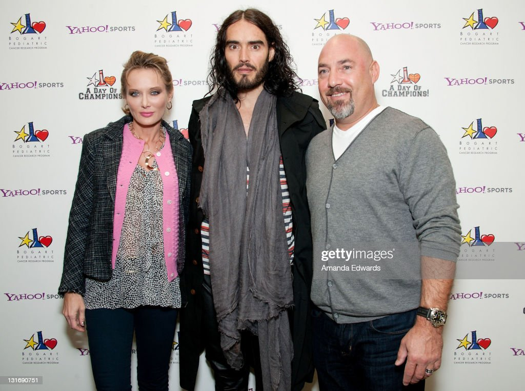 Trina Venit, actor Russell Brand and talent agent Adam Venit attend the Yahoo! Sports Presents A Day Of Champions event at the Sports Museum of Los Angeles on November 6, 2011 in Los Angeles, California.