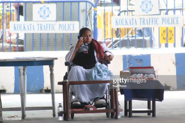 Trinamool Congress chief and West Bengal State Chief Minister Mamata Banerjee sitting wheelchair staged a dharna at Gandhi Murti in Kolkata, India on...